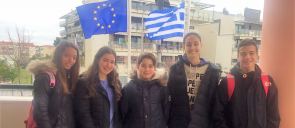 five students of mandoulides schools smiling after winning their awards