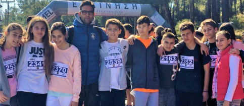 Mr stefanidis with 4 girls and 5 boys, students of mantoulides schools that took part in the event